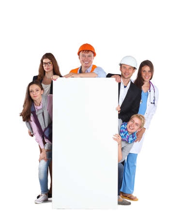 Portrait of smiling people with various occupations holding blank billboard . Stock Photo