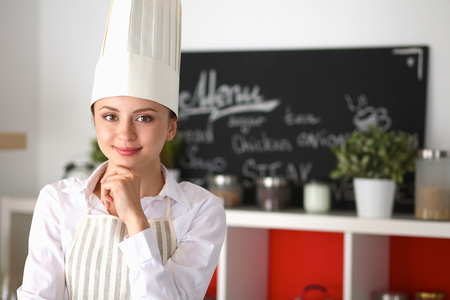 Chef woman portrait with  uniform in the kitchen . Zdjęcie Seryjne - 43998593