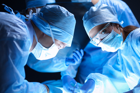 operation room: Team surgeon at work on operating in hospital . Stock Photo