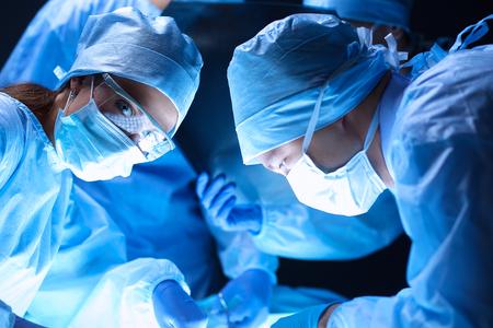 Team surgeon at work on operating in hospital . 免版税图像