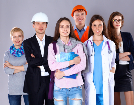 Portrait of smiling people with various occupations and showing ok .