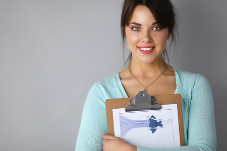 to the secretary: Woman with folder for documents on gray  background . Stock Photo