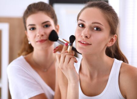 pampering: Two young women pampering themselves at a sleepover.