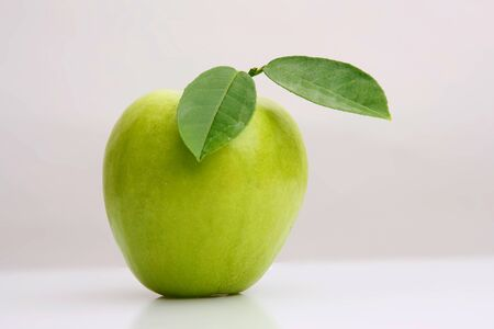 granny smith apple: Close-up of a ripe granny smith apple isolated on a light grey background.Green apple