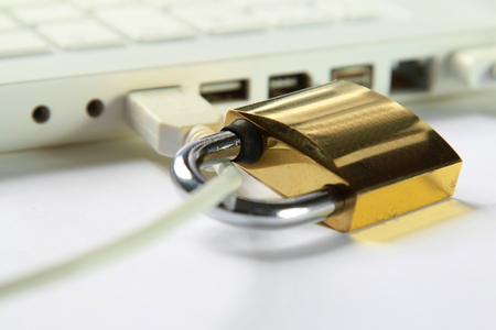 security symbol: A closed lock on a laptop as a symbol of security Stock Photo