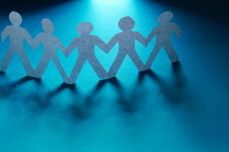 cut paper: Paper cut people, isolated on blue background
