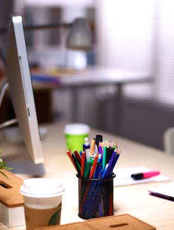 design studio: Designer's desk with laptop .