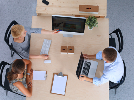 businessgroup: Group of business people working together in office .