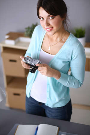proffessional: Woman is a proffessional photographer with camera . Stock Photo
