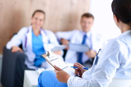 working together: Happy medical team discussing and working together . Stock Photo