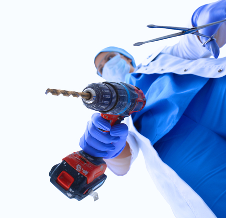 protective: Surgeon  wearing protective uniforms,caps and masks . Stock Photo