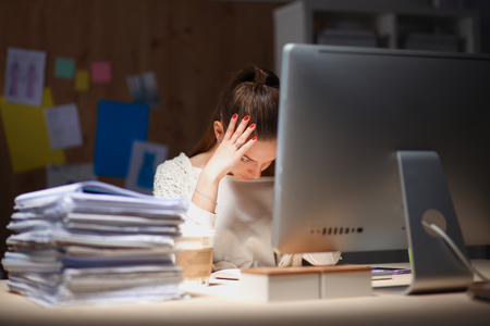 Young and beautiful businesswoman tired from work in the office.