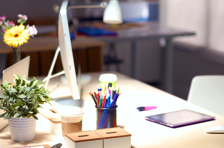 architectural studies: Designer desk with laptop in the office . Stock Photo