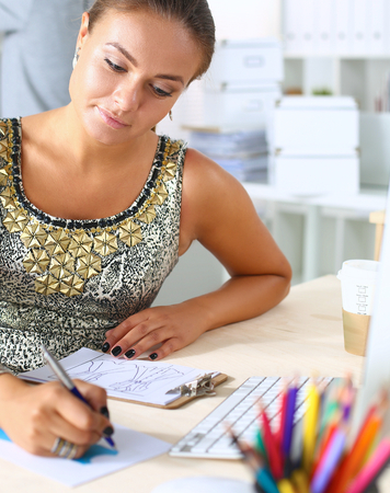 open plan: Young creative designer drawing a sketch in an open plan office space Stock Photo