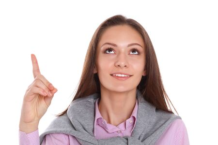 forefinger: Young woman pointing up with forefinger, isolated on white background Stock Photo