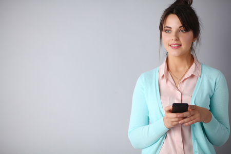 mobile internet: Woman using and reading a smart phone