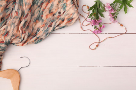 Woman clothing and accessories placed on a wooden background Archivio Fotografico