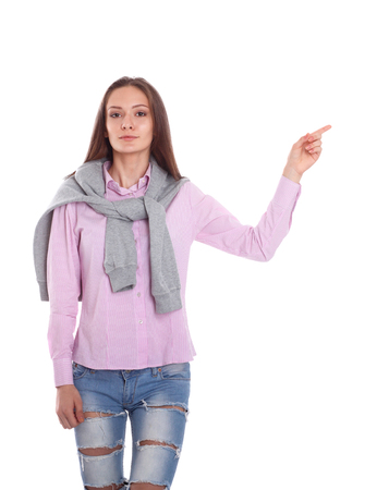 Young woman pointing up with forefinger, isolated on white background Stock Photo