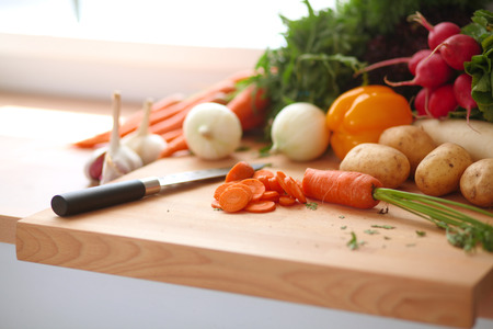 Vegetables on the desk in a kitchen .
