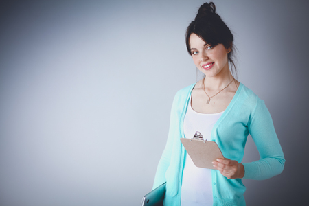 Woman with folder for documents on gray background Stock Photo