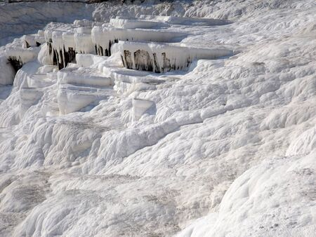 calcareous: The famous travertine and a thermal pool in Pamukkale, Turkey Stock Photo
