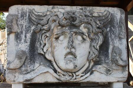 medusa: Medusa in ancient Temple of Apollo Didim Turkey Stock Photo