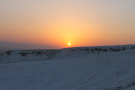 pamukkale: Sunset at Pamukkale health resort and nature reserve in Turkey, UNESCO sites Stock Photo