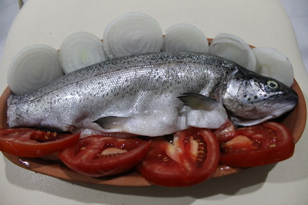 coal fish: Cooking fish from the Aegean sea bass in a ceramic pot on the coals