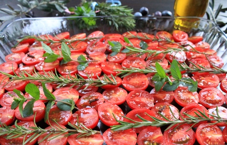 jerk: Cherry tomatoes prepared with jerk spices and olive oil, Mediterranean cuisine Stock Photo