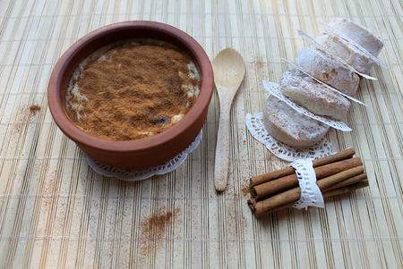 turkish dessert: Milk rice pudding, baked in the oven, sprinkle top with cinnamon, Turkish dessert syutlach and shortbread Stock Photo