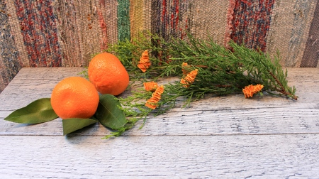arborvitae: New Year composition with tangerines, arborvitae branch, candles and orange Christmas trees