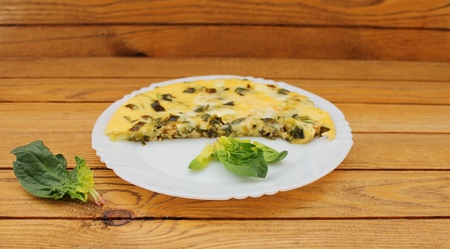 Omelet with spinach cooked in olive oil