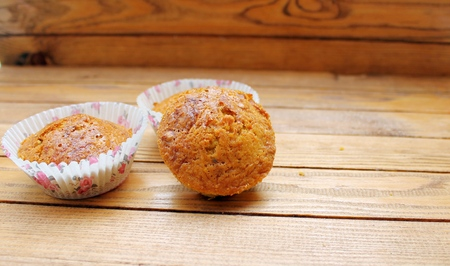 induced: Carrot muffins with raisins and nuts on a wooden table Stock Photo