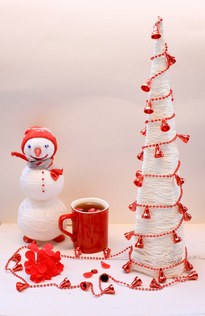 Merry Christmas and happy New Year Tea with Christmas tree and knitted snowman Stock Photo