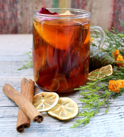 Winter tea with dried fruits, citrus and cinnamon