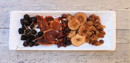Dried fruits on white tray on the table