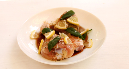 Chicken legs soaked in soy sauce, lemon and spices Stock Photo