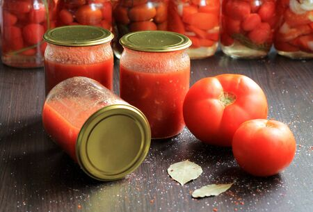 Canned tomatoes for the winter in banks. Tomato salads with vinegar.