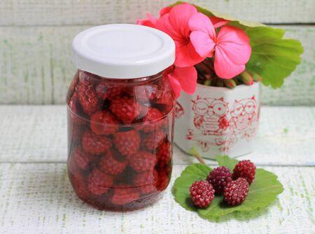 My grandmother's jam styling a blackberry jam in a glass jar