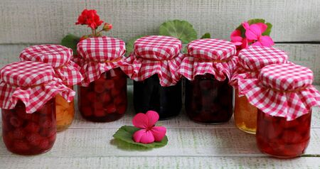 My grandmother's jam from different berries stylization in glass jars