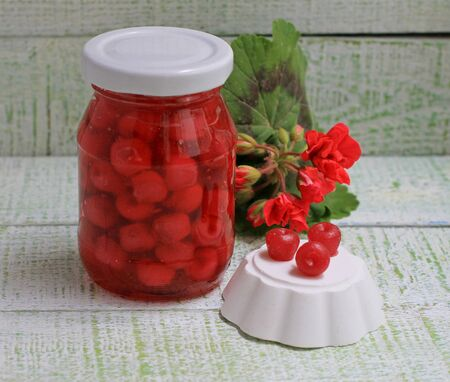 Jam of my grandmother styling cowberry jam in a glass jar