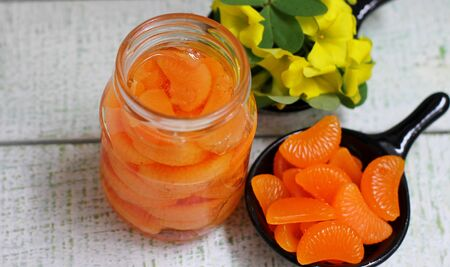 Jam of my grandmother stylized as a jam of tangerine cloves in a glass jar