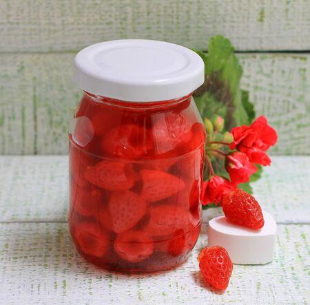 Jam of my grandmother styling strawberry jam in a glass jar
