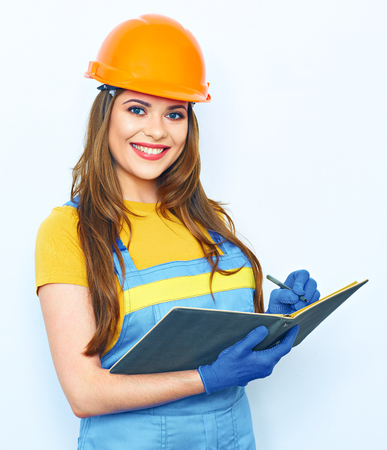 Engineer woman smile, hold business paper in builder uniform coveralls Stock Photo