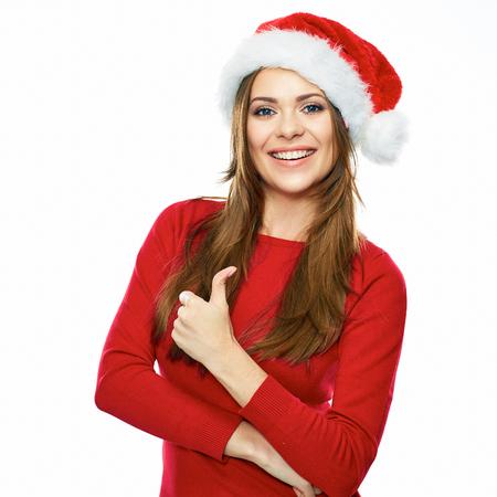 Lachende Santa girl thumb up show gekleed in rood. Stockfoto