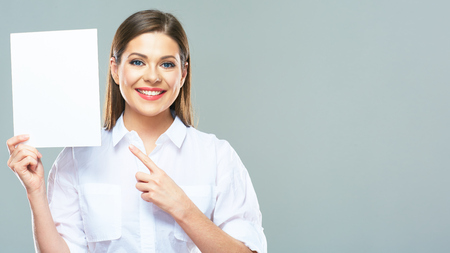 Smiling business woman finger pointing on sign board.