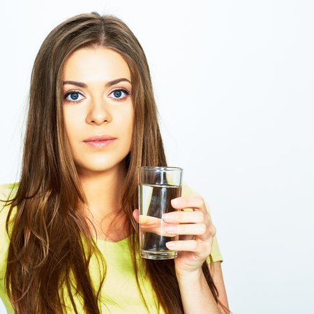 portrait of young woman with water glass . model with long hair . Stock Photo