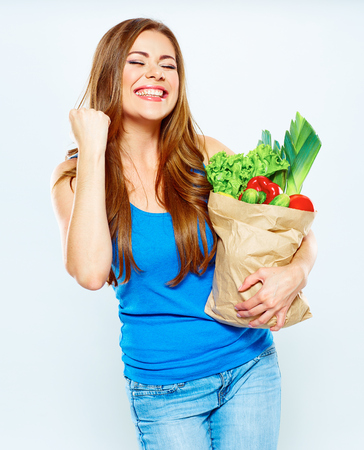 woman winner with green food . diet concept. white background .