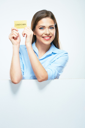 Woman show credit card. Portrait smiling business woman with blank sign board.