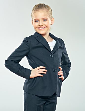 gir: Little smiling business woman studio portrai. Child gir dressed black business suit . Smiling girl.